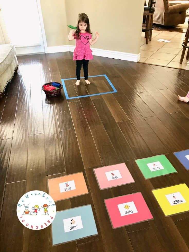 Set up this educational bean bag toss game! It's a great way to help kids learn action words (verbs) and build gross motor skills at the same time.