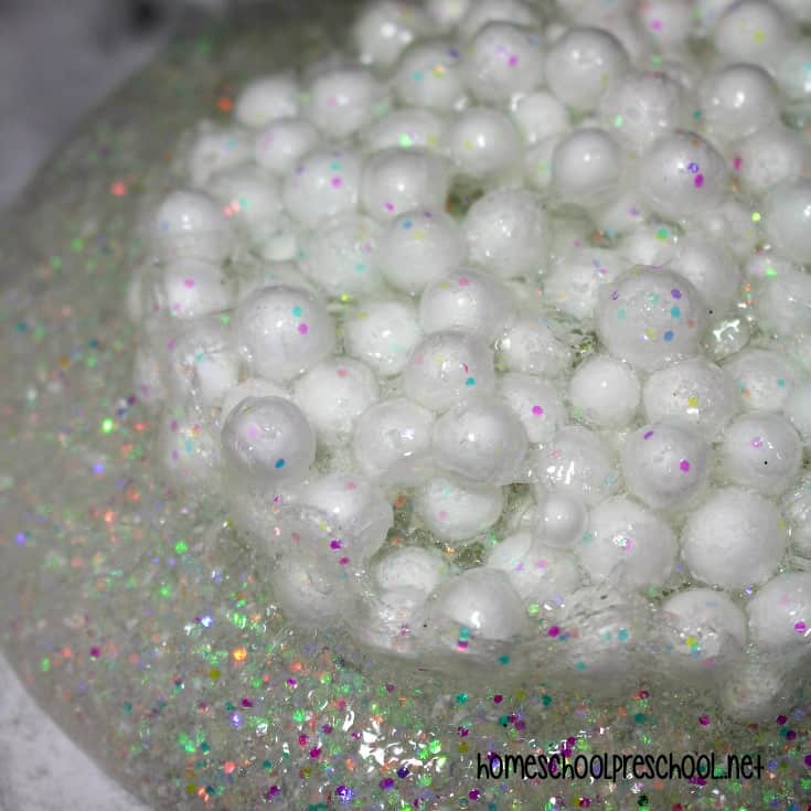 Your kids will love making this simple glittery snowball slime recipe this winter. It's a great activity to add to your winter sensory activities.